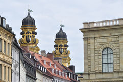 St. Cajetan's Church and Residenz Palace. The domes of St. Cajetan's Church – Theatinerkirche – in front the Residenz Palace in royalty free stock photos