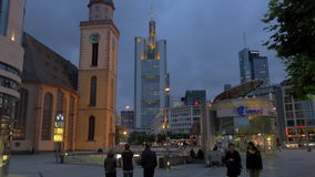 St. Catherine Church, subway entrance and skyscrapers in night Frankfurt. FRANKFURT, GERMANY - JULY 01, 2016: Night view of Hauptwache with St. Catherine Church stock footage
