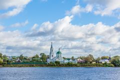 St. Catherine`s convent. Russia, the city Tver. View of the monastery from the Volga river. Picturesque clouds in the sky royalty free stock image