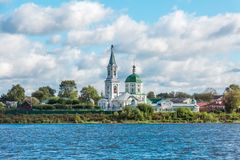 St. Catherine`s convent. Russia, the city Tver. View of the monastery from the Volga river. Picturesque clouds in the sky stock images