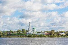St. Catherine`s convent. Russia, the city Tver. View of the monastery from the Volga river. Picturesque clouds in the sky stock photography