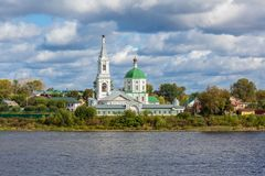 St. Catherine`s convent. Russia, the city Tver. View of the monastery from the Volga river. Picturesque clouds in the sky stock photo