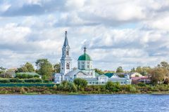 St. Catherine`s convent. Russia, the city Tver. View of the monastery from the Volga river. Picturesque clouds in the sky stock photos