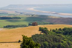 St Catherines Chapel, Abbotsbury, the Chesil Beach in the background. royalty free stock photography
