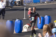 31st classic Athens marathon. Runner with baby on the 31st classic Athens marathon 2013 Royalty Free Stock Photography