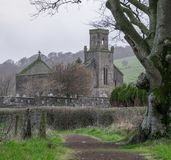 St Colmac church on Bute. Looing along the path and ander a tree to St Colmac church on Bute Stock Photo