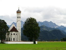 St Coloman church in alpine landscape Stock Images