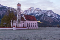 St. Coloman church in the morning, Alps, Germany Stock Photos