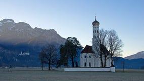 St. Coloman church in Schwangau. Saint Coloman church and Neuschwanstein Castle in Schwangau near Füssen in southwest Bavaria, Germany Royalty Free Stock Photo