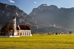 St. Coloman near Schwangau. The well-known church St. Coloman near Schwangau in Allgäu, Bavaria, Germany, with the famous Neuschwanstein Castle in the Stock Photography