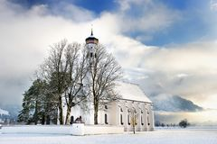 St. Coloman pilgrimage church, located near famous Neuschwanstein castle, Bavaria, Germany in winter day Stock Photos