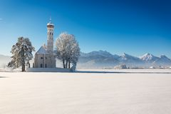 St. Coloman at a sunny winter day, Allgäu, Germany Stock Images