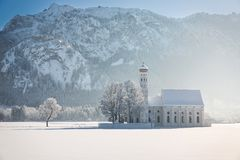 St. Coloman with trees in wintery landscape, Alps, Germany Stock Photo
