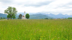 St Colomon church in the middle of meadow in Germany Stock Image