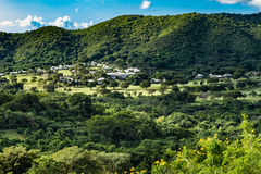 St. Croix countryside on the way to Christiansted. Drive through St. Croix along the seaside through the countryside. Small village at the base of the hillside Stock Images
