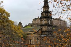 St. Cuthbert`s Church and Edinburgh Castle from Princes Street Garden Stock Images
