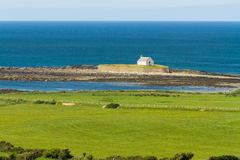 St Cwyfan's, The Church in the Sea. Looking out to see at high tide at St Cwyfan's Church, the Church in the Sea. Llangwyfan, Aberffraw, Anglesey, Wales Royalty Free Stock Images