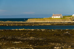 St Cwyfan's, The Church in the Sea. Looking out to see at high tide at St Cwyfan's Church, the Church in the Sea. Llangwyfan, Aberffraw, Anglesey, Wales Royalty Free Stock Photos