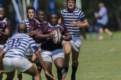 1st de Teamsmiddelbare scholen van de rugbyactie Stock Afbeelding