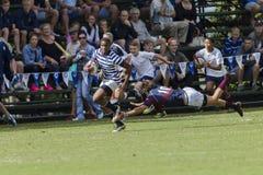1st de Teamsmiddelbare scholen van de rugbyactie Stock Fotografie