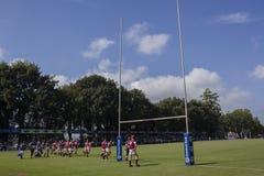 1st de Teamsmiddelbare scholen van de rugbyactie Royalty-vrije Stock Afbeeldingen