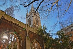 St Dunstan in the East Church Garden with a sun star in the financial district of the City of London. London, UK royalty free stock photography