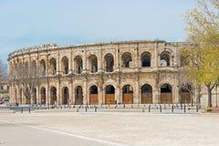1st för århundrade romerska amfiteater F. KR. i Nimes, Frankrike Arkivbild