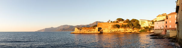 St. Florent at evening light. Stock Image