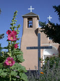 St. Francis of Asisi Catholic Church with Hollyhocks. St. Francis of Asisi Catholic Church, near Taos, New Mexico, with flower gardens including hollyhocks Stock Photo