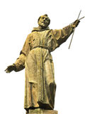 St Francis of Assisi. Statue in carved in stone of St Francis of Assisi  holding a cross into the sky isolated against a white background Stock Photo