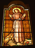 St Francis of Assisi. Stained glass in a church, Italy Royalty Free Stock Images