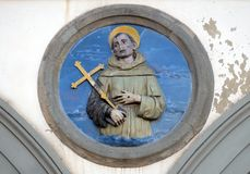 St. Francis of Assisi, Ospedale di San Paolo in Florence. St. Francis of Assisi, glazed terracotta tondo by Andrea della Robbia, located between two arches of stock photo