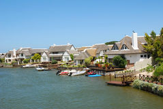 St. Francis Bay - South Africa. The famous white houses with their black reed roofs next to a river in St. Francis Bay, Eastern Cape Province, South Africa Royalty Free Stock Images