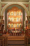 St. Francis Cathedral. An interior view of St. Francis Cathedral in Santa Fe, New Mexico. The cathedral is distinctive for its odd painted altar screen depicting stock image