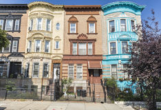 St. Francis Place Pastel Apartment Buildings. A row of historic brick apartment buildings on St. Francis Place in the Crown Heights Neighborhood of Brooklyn, New Royalty Free Stock Photography