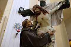 St. Francis removes Jesus from the cross Royalty Free Stock Image