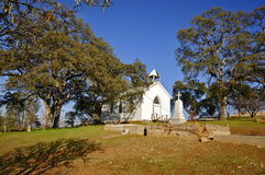 St Francis Xavier Church; Chinese Camp Ghost Town. Abandoned Catholic Church and Cemetery with old Gravestones of Chinese Camp; Tuolumne County, California Royalty Free Stock Photos