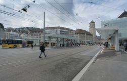 St. Gallen, SG / Switzerland - April 8, 2019: Sankt Gallen train station and local buses and commuter trains leaving the public
