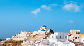 St George Church in Oia village on Santorini island, Greece. Travel background, with white houses and St George Church in Oia village on Santorini island, Greece Stock Photos