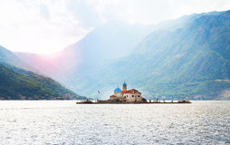 St.George Island and Our Lady of the Rock Island and Church in Perast on shore of Boka Kotor bay Boka Kotorska, Montenegro, Euro Stock Image