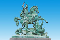 St. George kills the Dragon. St. George killing the Dragon, bronze statue made by Austrian sculptor Anton Fernkorn in 1853. It's standing next to the Croatian Stock Image