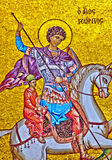 St. George Pobedonosets. St. George on horseback with a spear made in the mosaic on the wall of the temple Stock Image