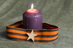 St. George ribbon and the candle royalty free stock photo