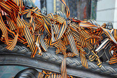 St. George ribbons tied to the iron fence Royalty Free Stock Image