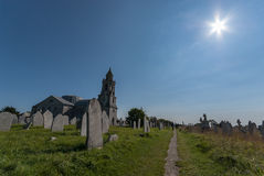 St George's Church, Portland. Dramatic wide angle shot looking across the graveyard of St George's Church, Portland on a clear sunny day Royalty Free Stock Images