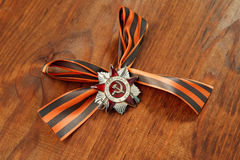 St. George's Ribbon and Order of the Patriotic War in St. on a wooden background Royalty Free Stock Images