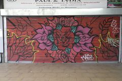 Graffiti on a closedup shop in the rundown shopping arcade St George``Walk in Croydon. St George`s Walk is a partially covered shopping parade in the centre of Royalty Free Stock Photos