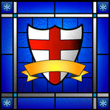 St George sköld i målat glassfönster Arkivbilder