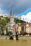 St. Georges church and bridge over Saone river in Lyon, France Stock Images
