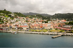 St. Georges, Grenada. A general view of St. Georges, capital of Grenada. It shows the buildings in the main part of the city and behind them are hills with Stock Photo
